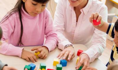 Teacher and children playing with blocks