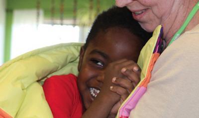 Child hugging teacher