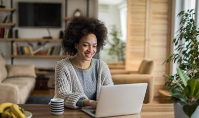 a woman at a computer at home