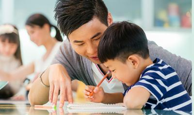 Father helping child with drawing