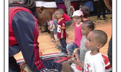 Children meeting WNBA players