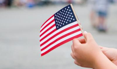 Young child holding an american flag