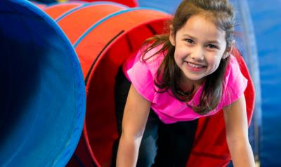 Girl playing in tunnel