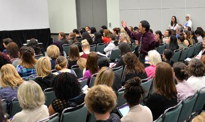 Individuals gather for session during Annual Conference