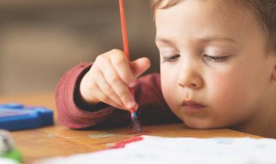 Boy holding a paintbrush