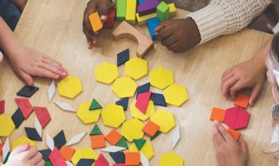 Children playing with shapes