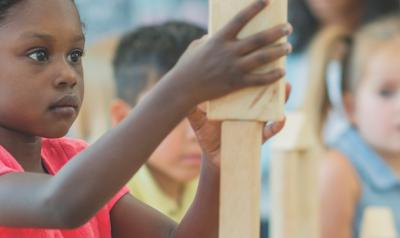Preschool students building with blocks