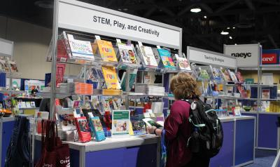 conference attendees browsing at NAEYC books.