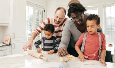Parents helping children in the kitchen