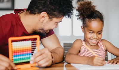 Father and daughter doing math activities