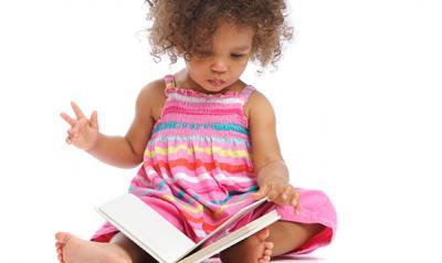 kindergartner girl reading a book