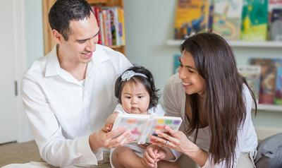 Family reading with toddler