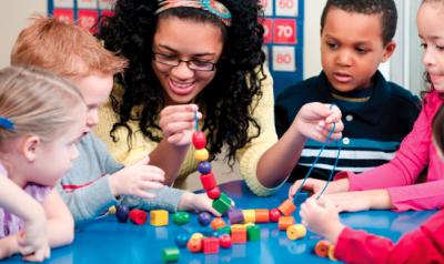 Teacher helping students build
