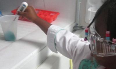 Child monitoring liquid in freezer