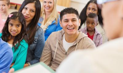 Adults and children in a learning environment.