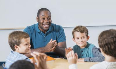 Teacher interacting with his three students.
