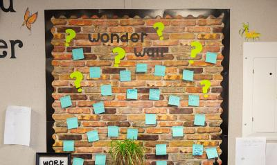 a wall with sticky notes on it