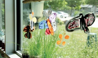 butterfly sculptures hanging in window