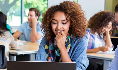Young woman participates in online learning.
