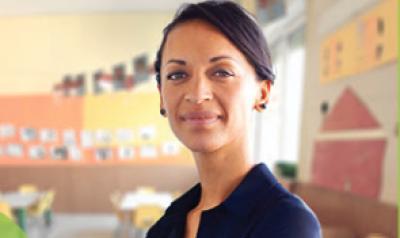 Teacher in a classroom smiling