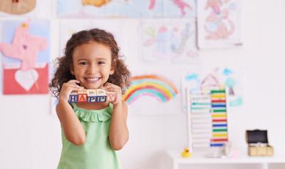 Preschooler holding blocks