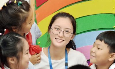 Teacher and three preschoolers in a classroom