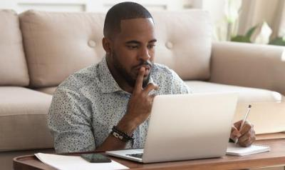 man at a laptop reading the screen