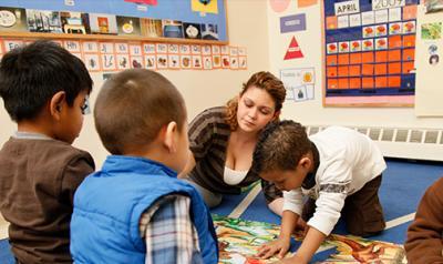 Teacher helping children with an activity