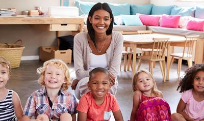 Happy teacher with happy students