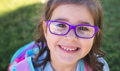 Girl in purple glasses