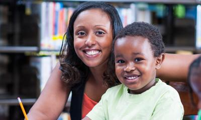 Educator with smiling child