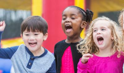 Children singing and smiling