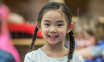 Little girl smiling while at school