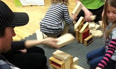 Young children playing with blocks in the classroom.