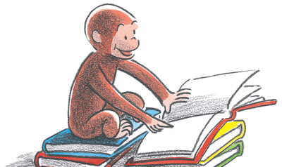Curious George reading a book