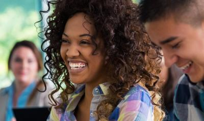 Two adult students laughing