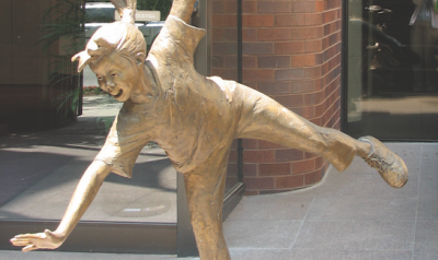 Golden child statue outside NAEYC headquarters