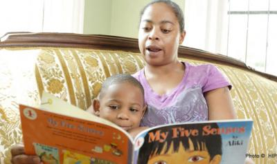Mother reading a children's book to toddler son