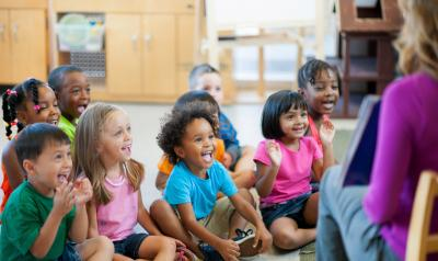 Preschool class sitting in circle for story time