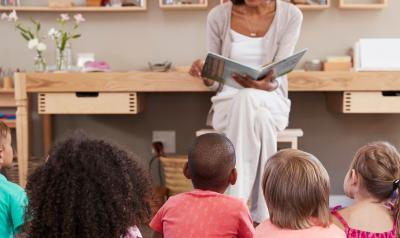 Teacher reading to preschool class