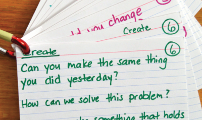 Index cards with sample questions for children.
