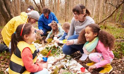 Children and adults working together to learn about the environment