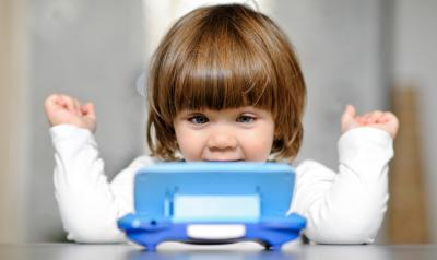 Child looking at a calculator