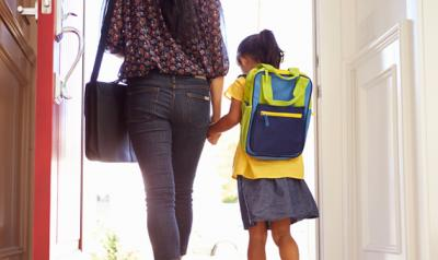 Mom and daughter walking into school holding hands