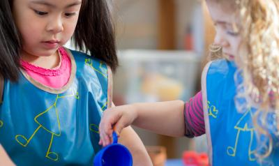 Two children at the water table