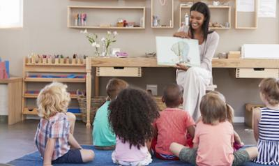 Teacher reading a book during storytime