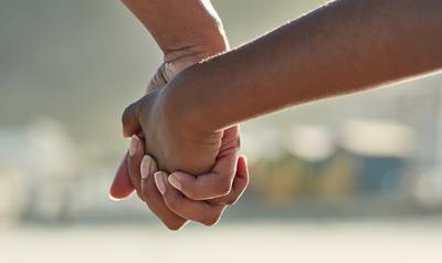 Adult and child hands together