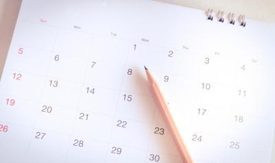 A pencil sits on a calendar.