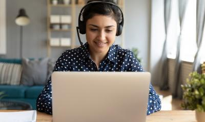 woman on a laptop smiling