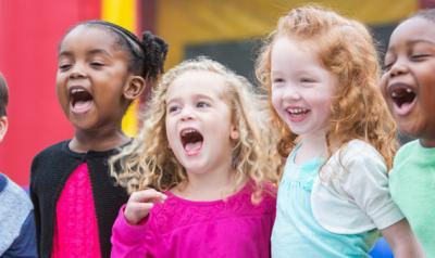 Kids singing and smiling